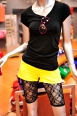 Fluorescent short shorts will draw guaranteed attention to alluring legs. Shorts $38.00, Sunglasses $9.99